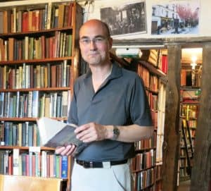 Darrin Qualman in Shakespeare and Company bookstore, Paris
